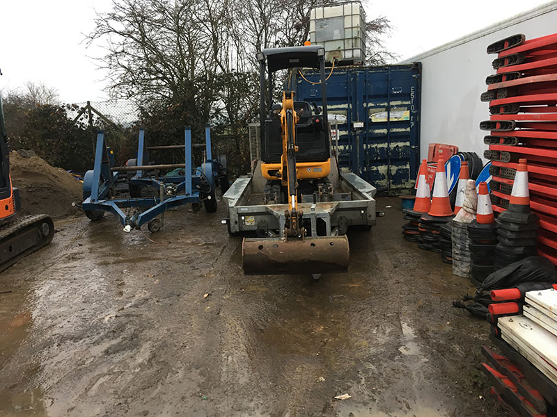 Mini digger on trailer